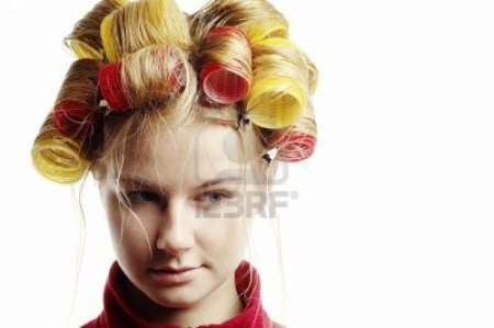 11428073-woman-with-hair-in-curlers