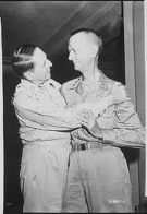 General of the Army Douglas MacArthur and Lieutenant General Jonathan Wainwright greet each other at the New Grand Hotel, Yokohama, Japan, August 31, 1945