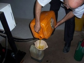 Pouring diesel from 5 gallon container to a 1 gallon container
