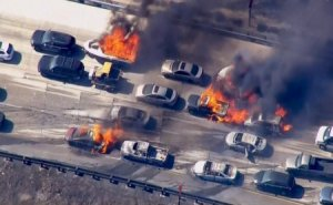 Frame grab from video of cars burning on Interstate 15 during a brush fire in the Cajon Pass, California. Cars are shown burning on the Interstate 15 freeway in the Cajon Pass, California in the frame grab from KNBC video July 17, 2015.  A brush fire burning in foothills north of Los Angeles overran a freeway in a mountain pass on Friday, torching several cars and trucks as drivers scrambled to safety.  REUTERS/NBCLA.COM/HANDOUT  FOR EDITORIAL USE ONLY. NOT FOR SALE FOR MARKETING OR ADVERTISING CAMPAIGNS  NO SALES NO ARCHIVES       TPX IMAGES OF THE DAY