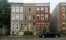 These abandoned and boarded apartments once gave some of their occupants lead poisoning, seen in the 1700 block of Mosher Street in Baltimore. WAPO