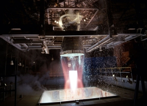 A modified Space Shuttle Main Engine is static fired at Marshall Space Flight Center's Technology Test Bed, in Huntsville, Alabama, on December 22, 1993.