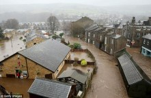 These incredible photographs show the widespread flooding in the Calder Valley town of Mytholmroyd, West