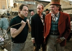"David Milch, left, creator of the HBO series ""Deadwood,"" demonstrates how actor Larry Cedar, center, should pull a cart on Deadwood's main street as actor Peter Jason watches during filming Wednesday, Feb. 9, 2005, in Santa Clarita, Calif. (AP Photo/Kevork Djansezian)"