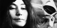 LONDON: Yoko Ono posed with a cigarette in Selfridges department store, Oxford Street, London in 1971 to promote the publication of the 2nd edition of her book Grapefruit (Photo by Gijsbert Hanekroot/Redferns)
